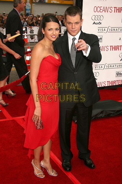 "LUCIANA BARROSO & MATT DAMON.""Ocean's Thirteen"" Los Angeles Premiere at Grauman's Chinese Theatre, Hollywood, California, USA..June 5th, 2007.full length dress black suit jacket strapless married husband wife red pointing .CAP/ADM/BP.©Byron Purvis/AdMedia/Capital Pictures"