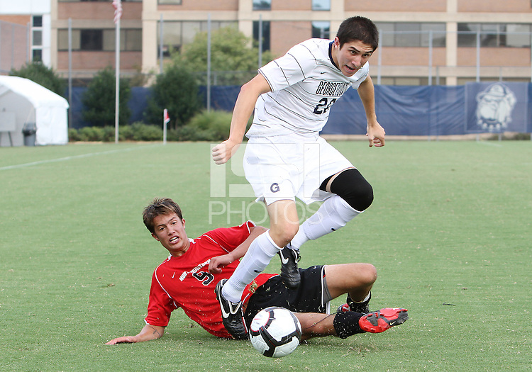 Andy Riemer #20 of Georgetown University gets past Ryan Burnham #9 of Northeastern University during an NCAA match at North Kehoe Field, Georgetown University on September 3 2010 in Washington D.C. Georgetown won 2-1 AET.