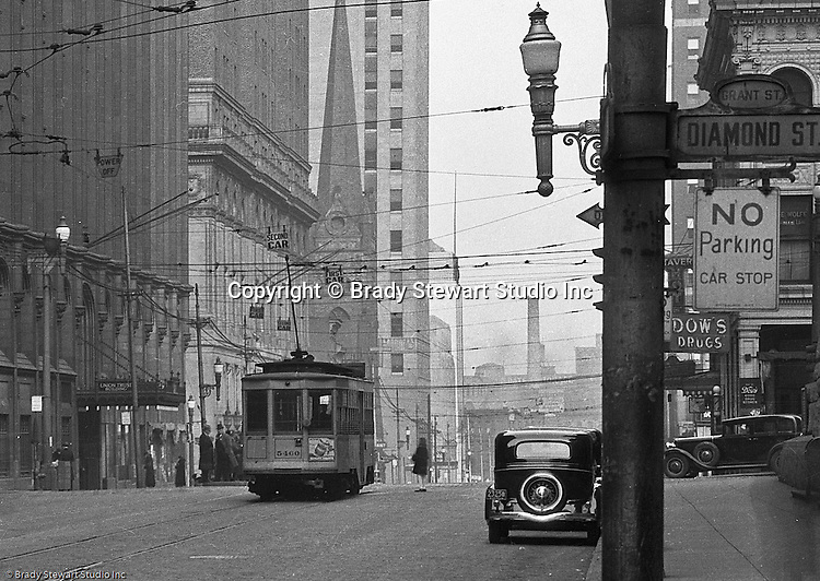 Pittsburgh PA:  View of a streetcar in front of the Union Trust Building on Grant Street - 1935.  Nearby buildings include; Oliver Building, Koppers Building, First English Evangelical Lutheran Church