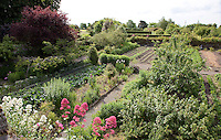 A view of the extensive vegetable garden with its rows of produce