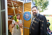 "Rabbi Levi Shemtov, Executive Vice President of American Friends of Lubavitch (Chabad), right, helps United States Representative Debbie Wasserman Schultz (Democrat of Florida), left, bless the Lulav and Ethrog at the Celebration of Sukkot at the US Capitol, sponsored by the Capitol Jewish Forum. Over 100 Congressional staffers of both parties and Houses joined Members of Congress for the annual event. The Capitol Jewish Forum is a project of American Friends of Lubavitch (Chabad) intended to ""create and enhance a sense of identity and community among Jewish Congressional staffers and Members of Congress.""<br /> Credit: Ron Sachs / CNP"