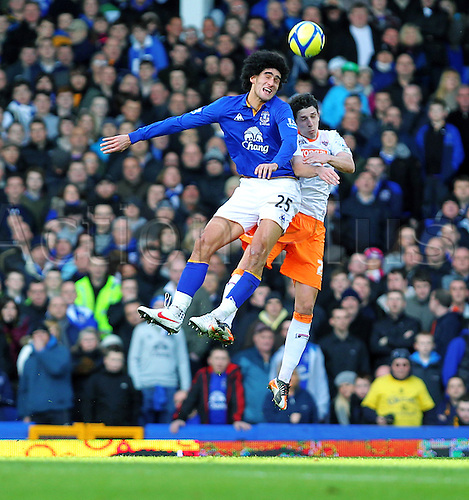 18.2.2012 Liverpool, England. Everton.Belgian Midfielder Marouane Fellaini and Blackpool Paul Bignot in heading action during the Budweiser FA Cup match between Everton and Blackpool, played at Goodison Park. Everton won by a score of 2-0 to move into the 6th round.