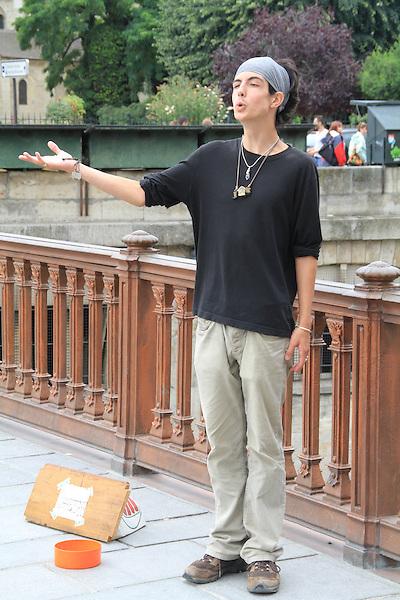 Street performer on a bridge in Paris, France.