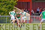Chris O'Leary Kilcummin releases the ball under pressure from Eamon John O'Donoghue St Kierans in Brosna on sunday