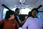 Ipixuna village, Amazon, Brazil. Father and son with kidney failure being airlifted by pilot Machado to Altamira hospital.