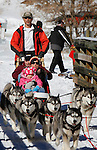 LEAD, SD - FEBRUARY 2, 2013:  Jack Christopher of Silent Run Adventures takes off with passengers Gary Linn and his daughter Kaylee Linn and granddaughter Bella Linn for a dogsled ride at the Kirk Trailhead on the Mickelson Trail south of Lead, S.D. Saturday February 2, 2013.  (Photo by Richard Carlson/dakotapress.org)