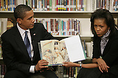 "Washington, DC - February 3, 2009 -- United States President Barack Obama and First Lady Michelle Obama made a visit to the Capitial City Public Charter School to visit with the 2nd Grade Class and read the book ""The Moon Over Star"" to them. .Credit: Gary Fabiano - Pool via CNP"