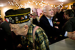 Robert Lynn, a Navy veteran, at a campaign stop for Sen. John McCain (R-AZ, right) in Bridgewater, NH, on Tuesday, Jan. 1, 2008.
