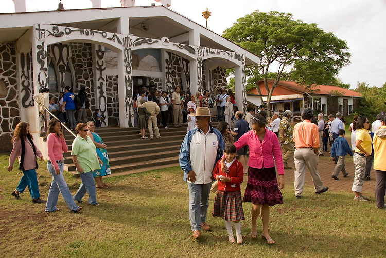 Chile, Easter Island: People outside Catholic Church after Sunday morning mass in Hanga Roa..Photo #: ch341-33075..Photo copyright Lee Foster www.fostertravel.com lee@fostertravel.com 510-549-2202