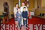 Scoil Naisunta Eirc pupils Jack Mac Gearailt and Gavin O Cinneide with their teacher Aine de Londra and Ath. Eoghan O Cadhla, the day of their First Communion at Carrig Church on Saturday noon..
