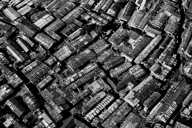 An aerial view of Kibera, one of the most densely populated places on earth. An average of 1,500 people live in an area the size of a football pitch, or the rough area of this picture. Over 25 percent of Nairobi's population live in Kibera, an area that covers less than one percent of the city. Although the population of the slum is over one million, it is recognised officially as a 'squat', or illegally occupied land, which allows the government to ignore the basic needs of the inhabitants.