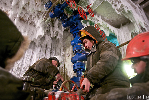 Workers test a gas drilling facility at the  Kumzhinskoe gas field, located in the delta of Pechora River, 60 km from Narjan-Mar city in Russia&rsquo;s Nenets Autonomous Region. In 1979, an explosion in one of the wells caused an uncontrolled gas fountain, with the condensate polluting huge areas of the tundra around, including the Pechora River. In May 25, 1981, the Soviets tried to collapse the field with an underground nuclear explosion at 1470 m depth. The explosion went wrong, causing even more damage and pollution. After that the field was closed and the area marked a nature reserve. <br /> <br /> Recently, more gas was found in the area. In 2007, then-President Vladimir Putin signed a decree demarcating the area from the nature reserve so that drilling work can resume. Environmentalists condemn this, saying the project too prone to further accidents in a delicate environment.