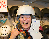 Sweden, SWE, Kiruna, 2008Mar22: A forty years old woman trying a ski helmet in a sports shop.