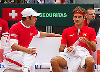 16-09-12, Netherlands, Amsterdam, Tennis, Daviscup Netherlands-Suisse, Roger Federer  On the Suisse bench with captainSeverin Luthi