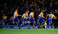 Mansfield Town's Krystian Pearce, second in from right celebrates scoring the opening goal<br /> <br /> Photographer Chris Vaughan/CameraSport<br /> <br /> The EFL Sky Bet League Two - Mansfield Town v Lincoln City - Monday 18th March 2019 - Field Mill - Mansfield<br /> <br /> World Copyright © 2019 CameraSport. All rights reserved. 43 Linden Ave. Countesthorpe. Leicester. England. LE8 5PG - Tel: +44 (0) 116 277 4147 - admin@camerasport.com - www.camerasport.com