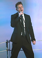 Quebec singer Bernard Lachance performs during the telethon operation Enfant-Soleil held at the pavillon de la Jeunesse in Quebec city May 31, 2009. Lachance was recently featured on the Oprah Winfrey show, only the second French Canadian with Celine Dion.