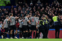 Newcastle players congratulate Ciaran Clark after scoring their opening goal during Chelsea vs Newcastle United, Premier League Football at Stamford Bridge on 12th January 2019