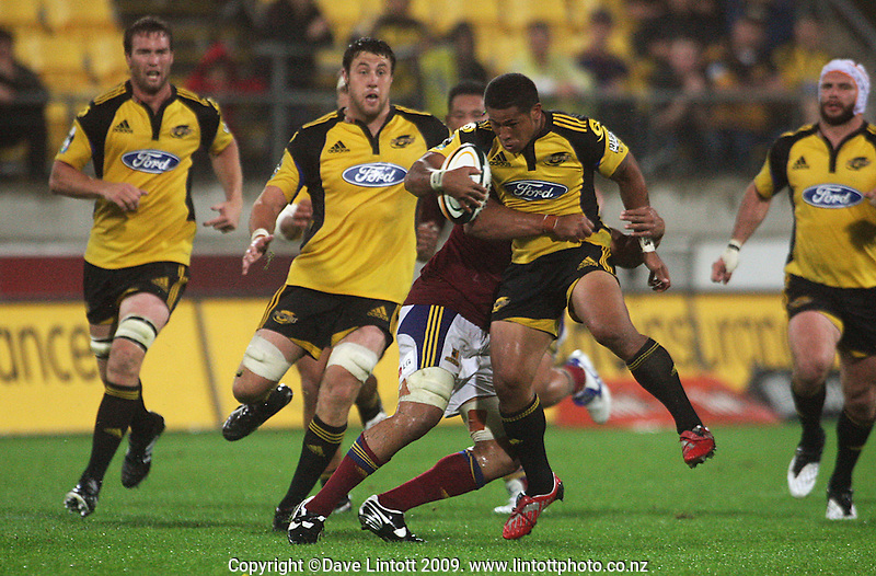 Hurricanes winger David Smith is tackled by Steven Setephano during the Super 14 rugby union match between the Hurricanes and Highlanders at Westpac Stadium, Wellington, New Zealand on Friday 20 February 2009. Photo: Dave Lintott / lintottphoto.co.nz