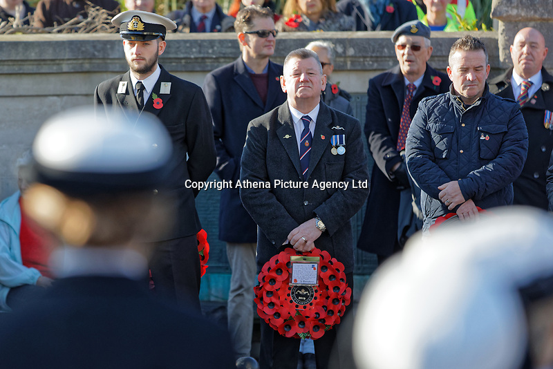 Pictured: People attending at the Cenotaph in Swansea, Wales, UK. Sunday 10 November 2019<br /> Re: Remembrance SUnday, a service to commemorate those who lost their lives in conflict has been held at the Cenotaph in Swansea, Wales, UK.