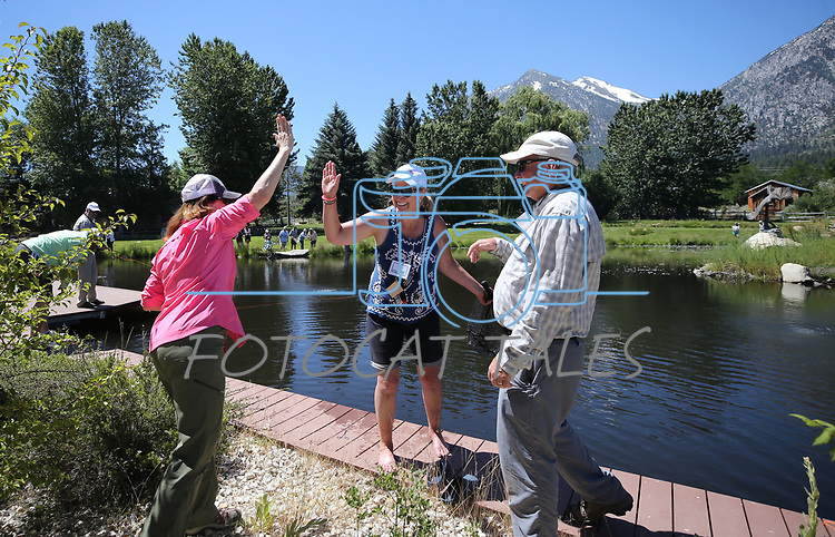 Breast cancer survivor Susan Powell, center, celebrates with program director Peggy Stevenson, left, and guide Kim Epstein during a Casting for Recovery retreat in Gardnerville, Nev., on Friday, June 30, 2017. <br /> Photo by Cathleen Allison/Nevada Photo Source