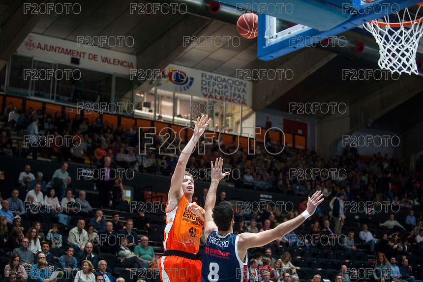 VALENCIA, SPAIN - OCTOBER 31: Juanjo Triguero and Hamilton during ENDESA LEAGUE match between Valencia Basket Club and Rio Natura Monbus Obradoiro at Fonteta Stadium on   October 31, 2015 in Valencia, Spain