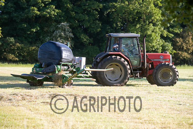 Tractor Wrapping Silage Bales