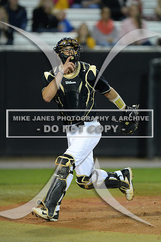 Central Florida Knights catcher Jordan Savinon (29) during the season opening game against the Siena Saints at Jay Bergman Field on February 14, 2014 in Orlando, Florida.  UCF defeated Siena 8-1.  (Copyright Mike Janes Photography)