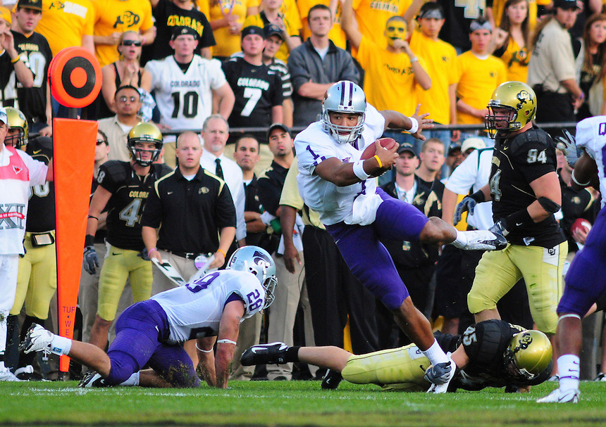 18 October 08: Kansas State quarterback Josh Freeman is tripped up as he rushes against Colorado. The Colorado Buffaloes defeated the Kansas State Wildcats 14-13 at Folsom Field in Boulder, Colorado.