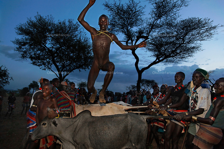 Hamar and Karo tribes practice bull jumping as a manhood ceremony. Karos only have the ceremony once a generation. Many of these men have illegitimate children before the ceremony and without exception those children are all killed. Karos are the only tribe that practice Mingi killing by putting dirt in their newborn children's mouths and leaving them to die.