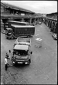 Delivery lorries servicing the many small businesses based in King's Cross Goods Yard, London 1989.