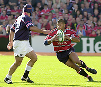 Photo Peter Spurrier.12/10/2002.Heineken European Cup Rugby.Gloucester vs Munster - Kingsholm.Gloucester front row.Gloucester's Robert Todd  side stepping Munster Mike Mullins