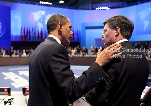 President Barack Obama talks with Prime Minister Dr. Jan Peter Balkenende of the Netherlands during the working lunch at the Nuclear Security Summit at the Walter E. Washington Convention Center in Washington, D.C., Tuesday, April 13, 2010.  President Obama was pleased to welcome the Dutch Prime Minister again to Washington.  The President thanked Prime Minister Balkenende for his continued friendship and strong leadership on Afghanistan, where Dutch forces are performing with distinction in the NATO mission.  The President looks forward to continued close cooperation with Prime Minister Balkenende. .Mandatory Credit: Pete Souza - White House via CNP