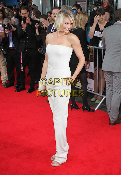 Cameron Diaz.The 'What To Expect When You're Expecting' UK film premiere, BFI Imax cinema, London, England..May 22nd, 2012.full length white strapless jumpsuit clutch bag hand in pocket side looking over shoulder .CAP/ROS.©Steve Ross/Capital Pictures.