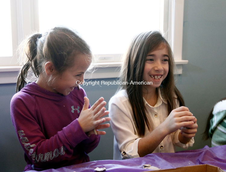 Newtown, CT- 27 December 2013-122813CM05- Lili Maunsell, 7, left, and Kaitlyn Alagno, 8, both from Oxford mold beads with clay during a Ben's Bells Project workshop in Newtown Saturday.  Volunteers make the long strands of bells and distribute them to communities in an effort to advocate kindness and healing.    Christopher Massa Republican-American
