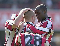 .Photo Peter Spurrier.06/04/2002.Nationwide Div 2.Brentford vs Huddersfield - Griffen Park:.Lloyd Osusu (Right), congratulates, Martin Rowlands (No.11) on his goal...
