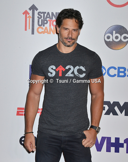 Joe Manganiello  at the  Stand Uo To Cancer 2014 at the Dolby Theatre in Los Angeles.