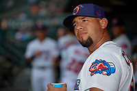 Jacksonville Jumbo Shrimp coach Jose Ceballos (30) jokingly looks at Jordan Yamamoto (not shown) before a Southern League game against the Mobile BayBears on May 28, 2019 at Baseball Grounds of Jacksonville in Jacksonville, Florida.  Mobile defeated Jacksonville 2-1.  (Mike Janes/Four Seam Images)