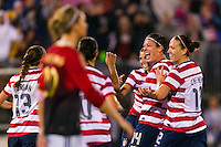 Tobin Heath (17) of the United States (USA) celebrates scoring with Abby Wambach (14), Lauren Cheney (12) and Alex Morgan (13). The United States (USA) and Germany (GER) played to a 2-2 tie during an international friendly at Rentschler Field in East Hartford, CT, on October 23, 2012.