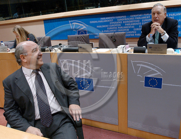 Brussels-Belgium - October 07, 2004---Hearing of European Commissioner Joaquín (Joaquin) ALMUNIA (Spain), at present and within the Barroso team designated to be in charge of 'Economic and Monetary Affairs', at the European Parliament's  Committee on 'Economic and Monetary Affairs'; here, the Commissioner (le) at the beginning of the meeting, talking with the Vicechairman of the committee, MEP Jose (José) Manuel GARCIA (García) -MARGALLO y MARFIL (EPP-ED, ES)(ri)---Photo: Horst Wagner/eup-images