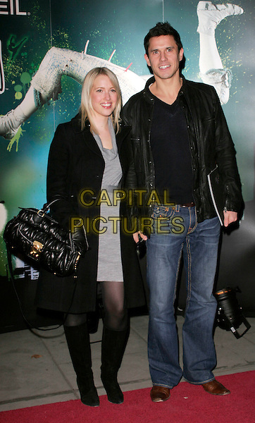 "JEREMY EDWARDS & GUEST .VIP Gala Premiere of Cirque de Soleil's ""Quidam"" at the Royal Albert Hall, London, England,  January 6th 2009.Cirque de Soleil full length black coat leather jacket jeans .CAP/AH.©Adam Houghton/Capital Pictures"