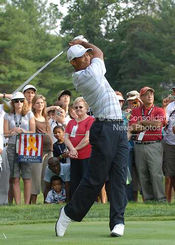 Bethesda, MD - July 4, 2007 -- Tiger Woods, Champion Golfer, drives the ball down range during the inaugural Earl Woods Memorial Pro-Am Tournament, part of the AT&T National PGA Tour event, Wednesday, July 4, 2007, at the Congressional Country Club in Bethesda, Maryland.  Woods donated 30,000 tournament tickets to military personnel to attend the event honoring soldiers and military families. .Credit: Molly A. Burgess - DoD via CNP.