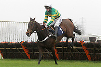 Race winner My Tent Or Yours ridden by A P McCoy in jumping action in the EBF Connollys Red Mills National Hunt Novices Hurdle Qualifier