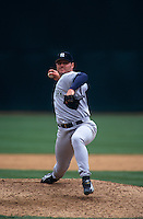 OAKLAND, CA - Roger Clemens of the New York Yankees pitches during a game against the Oakland Athletics at the Oakland Coliseum in Oakland, California in 1998. Photo by Brad Mangin
