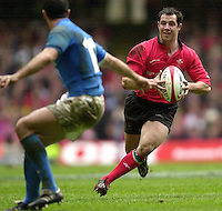 27/03/2004  -  RBS Six Nations Championship 2004 Wales v Italy.Welsh scrum half Gareth Cooper, wrong foots,  Roland de Marigny.   [Mandatory Credit, Peter Spurier/ Intersport Images].