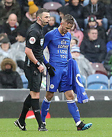 Leicester City's James Maddison is cautioned by Referee Michael Oliver for removing his shirt to reveal a 'RIP Sophie I Love You' message as he celebrated scoring the opening goal from a free-kick<br /> <br /> Photographer Rich Linley/CameraSport<br /> <br /> The Premier League - Burnley v Leicester City - Saturday 16th March 2019 - Turf Moor - Burnley<br /> <br /> World Copyright © 2019 CameraSport. All rights reserved. 43 Linden Ave. Countesthorpe. Leicester. England. LE8 5PG - Tel: +44 (0) 116 277 4147 - admin@camerasport.com - www.camerasport.com