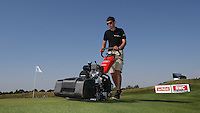 Mowing grass in sunglasses a fantastic occupation n'est pas? Green preparations underway during the preview days of the 2015 Alstom Open de France, played at Le Golf National, Saint-Quentin-En-Yvelines, Paris, France. /01/07/2015/. Picture: Golffile | David Lloyd<br /> <br /> All photos usage must carry mandatory copyright credit (&copy; Golffile | David Lloyd)