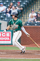 Avery Romero (1) of the Greensboro Grasshoppers follows through on his swing against the Hagerstown Suns at NewBridge Bank Park on May 20, 2014 in Greensboro, North Carolina.  The Grasshoppers defeated the Suns 5-4. (Brian Westerholt/Four Seam Images)