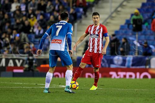 22nd December 2017, Cornella-El Prat, Cornella de Llobregat, Barcelona, Spain; La Liga football, Espanyol versus Atletico Madrid; Atletico captain Gabi is held up by Gerard of Espanyol during the match