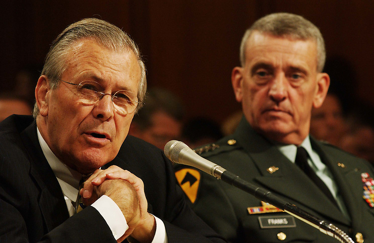 "7/9/03.IRAQ AND AFGHANISTAN--Defense Secretary Donald H. Rumsfeld and General Tommy R. Franks, Commander, United States Central Command, testify during the Senate Armed Services hearing on ""lessons learned"" during Operation Enduring Freedom in Afghanistan and Operation Iraqi Freedom..CONGRESSIONAL QUARTERLY PHOTO BY SCOTT J. FERRELL"