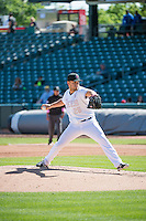 Chad Smith (26) of the Salt Lake Bees delivers a pitch to the plate against the Reno Aces in Pacific Coast League action at Smith's Ballpark on May 10, 2015 in Salt Lake City, Utah. Reno defeated Salt Lake 11-2 in Game Two of the double-header.  (Stephen Smith/Four Seam Images)